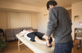 professional massage therapist treating patient in clinic